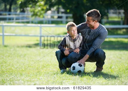 Father and son with football