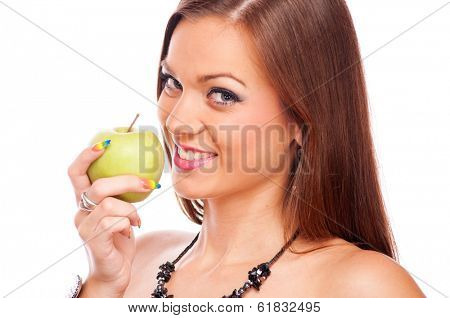 Beautiful brunette eating green apple, isolated on white