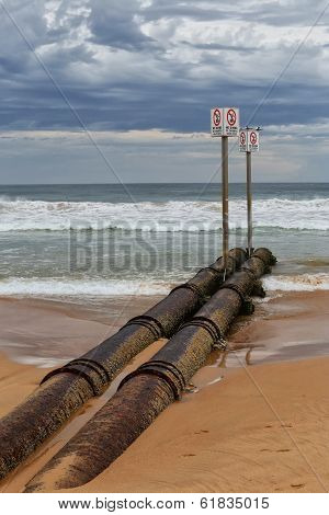 Waste pipe pumping effluent into the sea