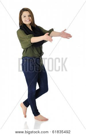 A beautiful, barefoot teen girl happily dancing and clapping in her casual attire.  On a white background.  Motion blur on clapping hands.