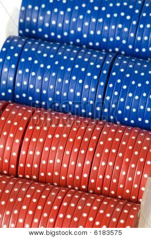 Closeup Of Poker Chips In Case On White