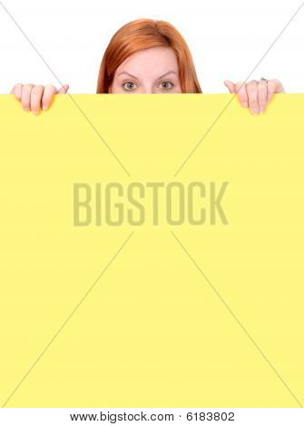 Red-haired Woman Peeking Over Wall