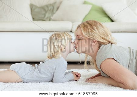 Mother with a child playing together at home