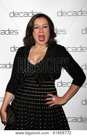 LOS ANGELES - MAR 20:  Jennifer Tilly at the Decades: Les Must De Moschino Event at Decades Boutique on March 20, 2014 in Los Angeles, CA