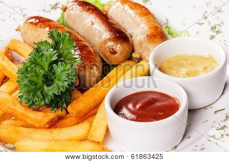Sausages A Grill With French Fries And Fennel