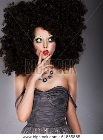 Vogue. Trendy Brunette In Lush Art Wig Grimacing. Creative Concept