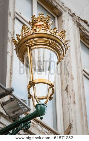 Antic Royal Street Lantern On A Wall In Brussel, Belgium