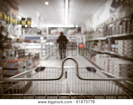 View From Shopping Cart Trolley At Supermarket Shop. Retail.