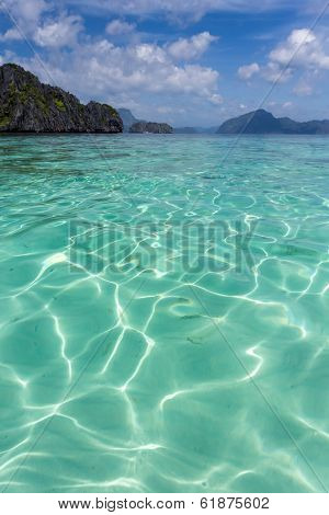 Crystal-clear blue water at El Nido in Palawan Province in the Philippines, a protected area of great natural beauty and a popular tourist attraction