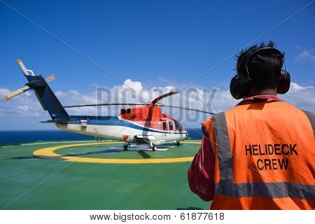 Shut down helicopter oil rig helipad with crew