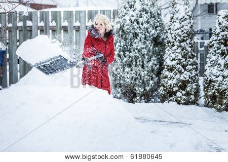 Woman Shoveling Her Parking Lot