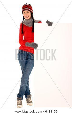 Winter girl holding blank sign