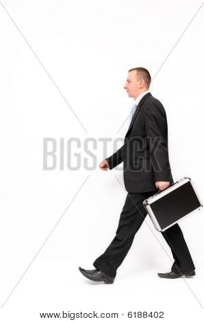 Businessman walking with briefcase