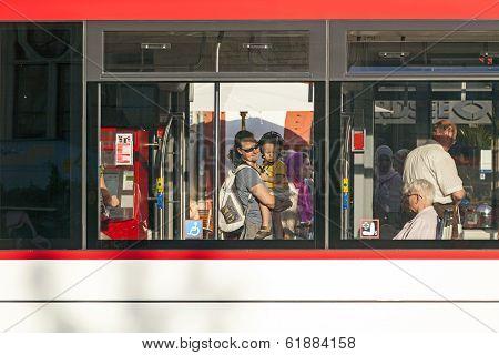 People In A Public Bus In Erfurt, Germany.