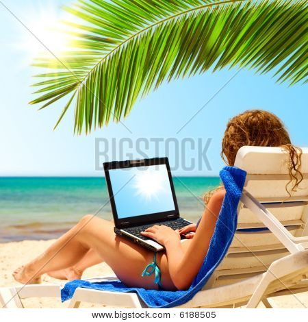 Laptop On Beach Sun