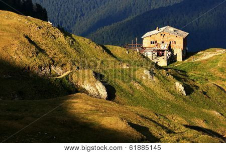 Mountain chalet in sunset light