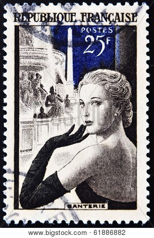 FRANCE - CIRCA 1939: A stamp printed in France a beautiful lady with a glove - gallantry
