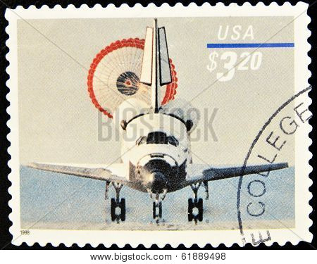 USA - CIRCA 1998: A stamp printed in United States of America shows the return of a spacecraft