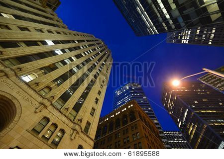 SAN FRANCISCO, CA - AUGUST 16, 2013: San Francisco Financial district at night with Shell Building and other iconic Buildings with blue sky background.