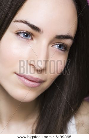 A Beautiful Young Woman Dreams Smiling