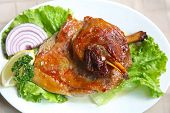 image of lamb shanks  - Roasted lamb shank served at dish with salad - JPG
