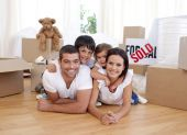 stock photo of happy family  - Happy family lying on floor after buying new house - JPG