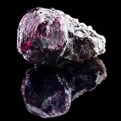 stock photo of uncut  - Natural Uncut Raw Ruby with reflection on black surface background - JPG