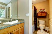 stock photo of master bedroom  - View of washbasin cabinet and small bathroom in master bedroom - JPG