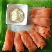 picture of blubber  - Fresh smoked Salmon with Horseradish on green Plate - JPG