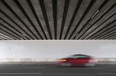 Bridge Underpass With Blurred Red Car