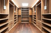 stock photo of wardrobe  - wide wooden dressing room - JPG