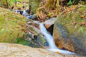 stock photo of upstream  - Upstream that flows through the rocks down below the forest national park - JPG