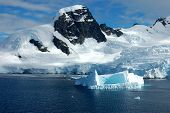stock photo of iceberg  - Mountains and icebergs off the Antarctica peninsula - JPG