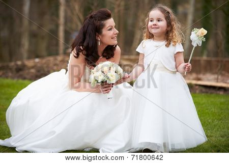 Bride With Bridesmaid On Wedding Day