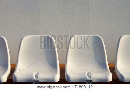 White plastic seats