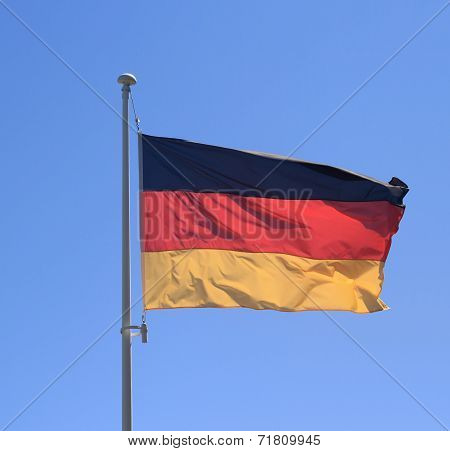 Flag Of Federal Republic Of Germany On Blue Sky