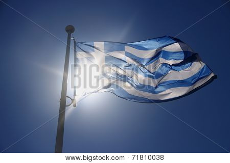 Greece Flag On Blue Sky, Backlit Subject
