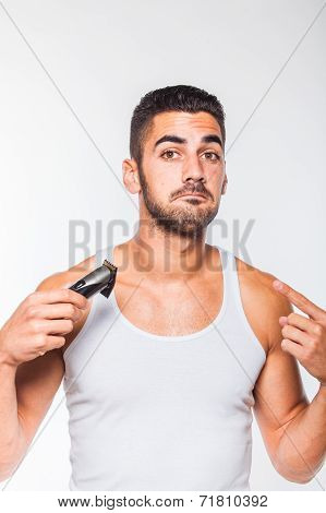 Young Handsome Man Trimming His Beard