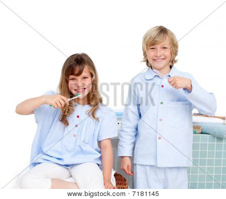 Smiling Brother And Siter Brushing Their Teeth