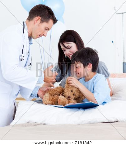Attractive Doctor Playing With A Little Boy And His Mother