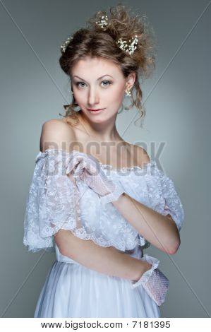 Beautiful Young Woman In White Dress
