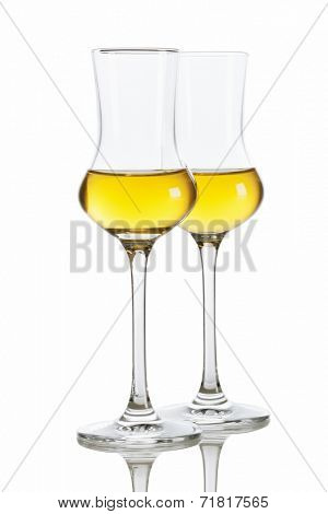 Two glasses of italian Grappa brandy isolated on white background