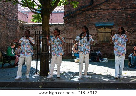 Street singers performing in historical city of York England.