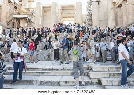 People Sightseeing Athena Nike Temple In Greece