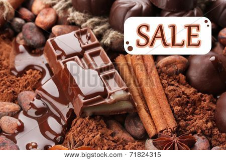 Concept of discount. Composition of chocolate sweets
