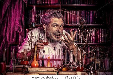Crazy old man medieval scientist working in his laboratory. Alchemist. Halloween.