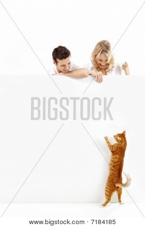 People With A Cat And An Empty Banner