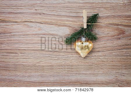 christmas golden heart with evergreen  twig