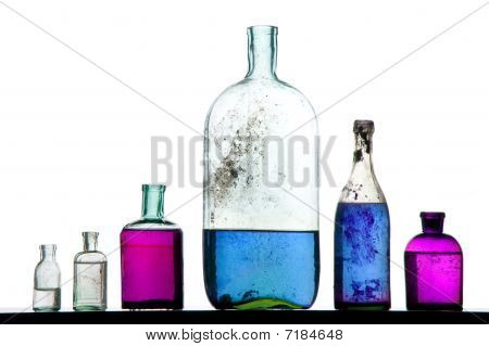 Colorful Liquid On Antique Bottles