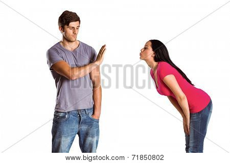 Man rebuffing the kiss of his girlfriend on white background